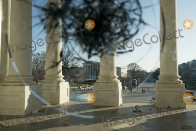 The Unit, Vandals Photo - A view through the broken windows of the front entrance doors of the U.S. Capitol in the aftermath the morning after a riot by pro-Trump supporters who stormed and vandalized the U.S. Capitol as Electoral votes were being counted during a joint session of the United States Congress to certify the results of the 2020 presidential election. Washington, DC, Thursday, January 7, 2021. Credit: Rod Lamkey / CNP/AdMedia