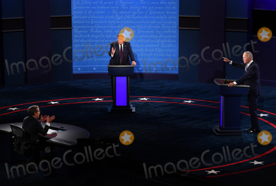 Presidential Campaign, Joe Biden, Vice President Joe Biden, CHRIS WALLACE Photo - United States President Donald J. Trump (C) and Democratic presidential nominee former United States Vice President Joe Biden (R), with Chris Wallace moderating, face off in the first of three scheduled 90 minute presidential debates, in Cleveland, Ohio, on Tuesday, September 29, 2020.Credit: Kevin Dietsch / Pool via CNP/AdMedia