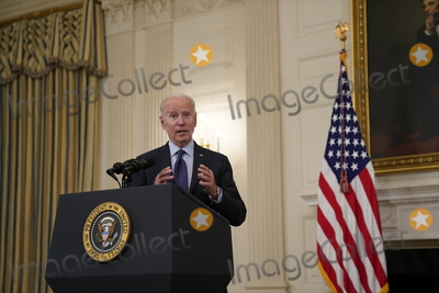 Joe Biden, The Vaccines, White House, The White Photo - United States President Joe Biden takes questions after delivering remarks on the Covid-19 response and the vaccination program from the State Dining Room of the White House in Washington, DC on Tuesday, May 4, 2021.  The President announced he will allow some governors to turn down doses they don't need or want and reallocate those doses to other states and he also set a goal of getting at least one dose of the Covid-19 vaccine to 70 percent of adults by July 4.Credit: Alex Edelman / Pool via CNP/AdMedia