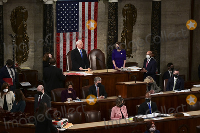 Joe Biden, Nancy Pelosi, Representative Nancy Pelosi, The Unit, Mike Pence Photo - U.S. Vice President Mike Pence, center left, speaks as Speaker of the United States House of Representatives Nancy Pelosi (Democrat of California), center right, listens during a joint session of Congress to count the Electoral College votes of the 2020 presidential election in the House Chamber in Washington, D.C., U.S., on Wednesday, Jan. 6, 2021. Congress is meeting to certify Joe Biden as the winner of the 2020 presidential election, with scores of Republican lawmakers preparing to challenge the tally in a number of states during what is normally a largely ceremonial event. Credit: Erin Scott / Pool via CNP/AdMedia