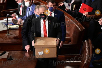 Joe Biden Photo - Electoral College ballot boxes arrive to a joint session of Congress to count the Electoral College votes of the 2020 presidential election in the House Chamber in Washington, D.C., U.S., on Wednesday, Jan. 6, 2021. Congress is meeting to certify Joe Biden as the winner of the 2020 presidential election, with scores of Republican lawmakers preparing to challenge the tally in a number of states during what is normally a largely ceremonial event. Credit: Erin Scott / Pool via CNP/AdMedia