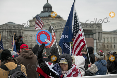 Sounds, The Sounds, The Unit, The Used, President Trump Photo - People pray to the sound of a Bile passage over a bullhorn, as a small crowd of President Trump supporters gather on the west side of the U.S. Capitol in the hours before the Electoral votes are to be counted during a joint session of the United States Congress to certify the results of the 2020 presidential election in the US House of Representatives Chamber in the US Capitol in Washington, DC on Wednesday, January 6, 2021. Congressional Republicans have announced they are going to challenge the Electoral votes from up to six swing states.Credit: Rod Lamkey / CNP/AdMedia