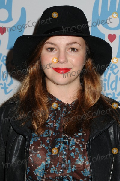 Amber Tamblyn Photo - 16 November 2014 - Culver City, California - Amber Tamblyn. Save A Child's Heart Celebration held at Sony Pictures Studios. Photo Credit: Byron Purvis/AdMedia
