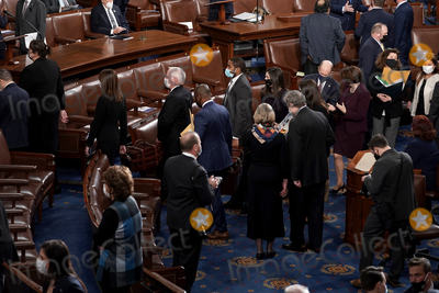 Photo - Senators and Senate clerks leave to debate the certification of Arizona's Electoral College votes from the 2020 presidential election during a joint session of Congress on Wednesday, January 6, 2021.