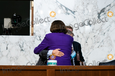 Dianne Feinstein, Donald Trump, Lindsey Graham, Senator Dianne Feinstein, Senator Lindsey Graham, Supremes, Supreme Court Photo - United States Senator Lindsey Graham (Republican of South  Carolina), Chairman, US Senate Judiciary Committee and United States Senator Dianne Feinstein (Democrat of California), Ranking Member, US Senate Judiciary Committee, hug at the conclusion of the fourth day of the confirmation hearing for Judge Amy Coney Barrett, President Donald Trump's Nominee for Supreme Court, in Hart Senate Office Building in Washington DC, on October 15th, 2020.Credit: Anna Moneymaker / Pool via CNP