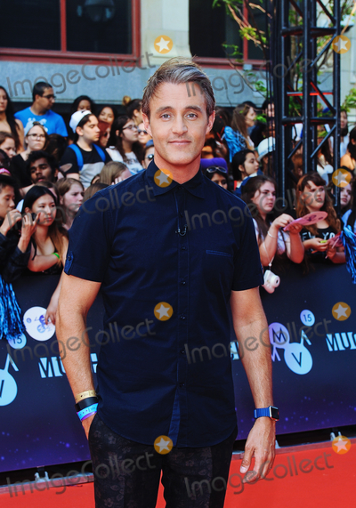 """Ben Mulroney, Brian Mulroney Photo - 22 June 2020 - Ben Mulroney, husband of Jessica Mulroney and the son of former prime minister Brian Mulroney, steps down as host of CTV's """"eTalk"""", due to the fallout from his wife's recent scandal. File Photo: MMVAs 2015, Toronto, Ontario, Canada. Photo Credit: Brent Perniac/AdMedia"""