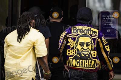 George Floyd, Ministry, Warrant, Police Officer Photo - Damik Wright (R) heads into the memorial service for his brother, Daunte Wright, at Shiloh Temple International Ministries in Minneapolis, M.N., U.S., on Tuesday, April 20, 2021. Wright was shot by police officer Kimberly Ann Potter who claims she thought she was deploying a taser when Wright attempted to flee police when they attempted to place him under arrest for an outstanding warrant during a traffic stop for expired registration tags. Credit: Samuel Corum / CNP