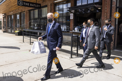 Joe Biden Photo - United States President Joe Biden departs after picking up tacos during a visit to Las Gemelas Restaurant  in Washington, DC, USA, 05 May 2021.United States President Joe Biden picks up tacos during a visit to Las Gemelas Restaurant  in Union Market to highlight the successes of the American Rescue Plan (ARP) in Washington, DC, USA, 05 May 2021.  Las Gemelas is a beneficiary of relief funding from the pilot program Restaurant Revitalization Fund.  The ARPs Restaurant Revitalization Fund provides $28.6 billion in direct relief to restaurants and food and beverage establishments, and prioritizes restaurants that are women-owned, veteran-owned, and owned by other socially and economically disadvantaged individuals.Credit: Jim LoScalzo / Pool via CNP/AdMedia