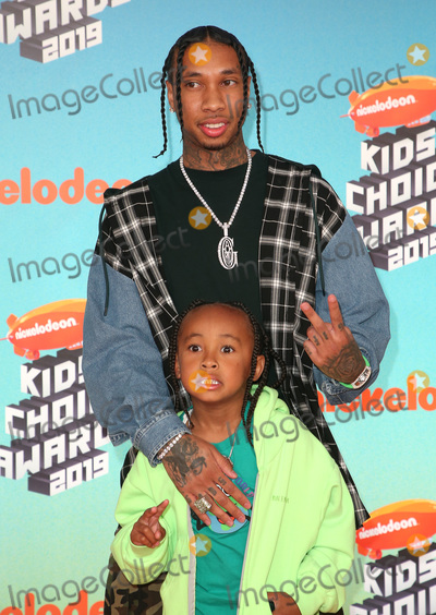 Tyga, King Sunny Adé Photo - 23 March 2019 - Los Angeles, California - Tyga and King Cairo. 2019 Nickelodeon Kids' Choice Awards held at The USC Galen Center. Photo Credit: Faye Sadou/AdMedia