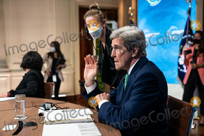 John Kerry, The Specials, White House, The White Photo - John Kerry, the Special Presidential Envoy for Climate, looks at his notes before the start of the virtual Leaders Summit on Climate in the East Room of the White House in Washington DC on April 23rd, 2021. Credit: Anna Moneymaker / Pool via CNP/AdMedia