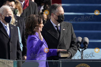 Joe Biden, Supremes, Kamala Harris, Supreme Court Photo - Kamala Harris is sworn in as vice president by Supreme Court Justice Sonia Sotomayor as her husband Doug Emhoff holds the Bible during the 59th Presidential Inauguration at the U.S. Capitol in Washington, Wednesday, Jan. 20, 2021. (AP Photo/Patrick Semansky, Pool)/AdMedia