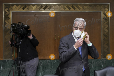 Barack Obama, Joe Biden Photo - Denis McDonough, U.S. secretary of Veterans Affairs (VA) nominee for U.S. President Joe Biden, removes his protective mask during a Senate Veterans' Affairs Committee confirmation hearing in Washington, D.C., U.S., on Wednesday, Jan. 27, 2021. As Barack Obama's chief of staff, McDonough oversaw the VAs overhaul in response to its 2014 wait-time scandal and previously served as a deputy national security adviser. Credit: Sarah Silbiger / Pool via CNP/AdMedia