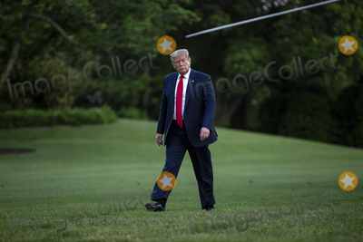 """Donald Trump, Kennedy, White House, The White, The National Photo - United States President Donald J. Trump walks on the South Lawn of the White House in Washington, D.C., U.S., as he arrives from the Kennedy Space Center in Florida on Saturday, May 30, 2020.  Trump vowed his administration would end what he called """"mob violence"""" in U.S. cities following the death of an unarmed black man at the hands of Minnesota police, blaming leftist groups for clashes with police and property damage around the nation. Credit: Stefani Reynolds / Pool via CNP/AdMedia"""