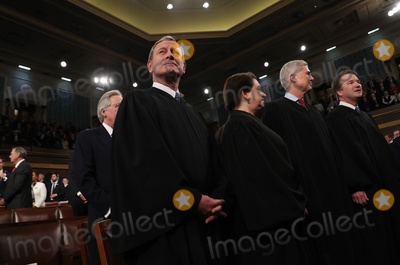 Donald Trump, John Roberts, The Unit, US Congress Photo - Chief Justice of the United States John Roberts, Associate Justice Elena Kagan, Associate Justice Neil Gorsuch and Associate Justice Brett Kavanaugh look on before the start of U.S. President Donald Trump's State of the Union address to a joint session of the U.S. Congress in the House Chamber of the U.S. Capitol in Washington, U.S. February 4, 2020. Credit: Leah Millis / Pool via CNP/AdMedia