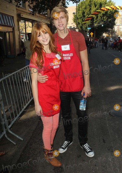 Anne Douglas, Bella Thorne, Skid Row, Tristan Klier Photo - 21 November 2012 - Los Angeles, California - Bella Thorne and Tristan Klier. Kirk And Anne Douglas Host 8th Annual Thanksgiving For Skid Row Homeless At Los Angele Mission Held At The Los Angeles Mission. Photo Credit: Kevan Brooks/AdMedia