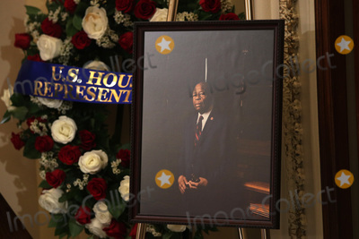 """Elijah Cummings, The Used, Alex Wong Photo - A portrait of United States Representative Elijah Cummings (Democrat of Maryland) is on display as the late congressman lies in state outside the US House chamber at the U.S. Capitol October 24, 2019 in Washington, DC. Rep. Cummings passed away on October 17, 2019 at the age of 68 from """"complications concerning longstanding health challenges."""" Credit: Alex Wong / Pool via CNP/AdMedia"""
