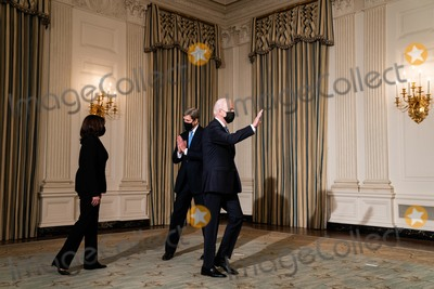Joe Biden, John Kerry, The Specials, White House, The White, Kamala Harris Photo - John Kerry, the Special Presidential Envoy for Climate, greets President Joe Biden and Vice President Kamala Harris before the start of an event on the administrations response to climate change at an event in the State Dining Room of the White House in Washington DC, January 27th, 2021.Credit: Anna Moneymaker / Pool via CNP/AdMedia