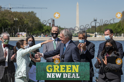 Ed Markey, The Used, Alexandria Ocasio-Cortez Photo - United States Representative Alexandria Ocasio-Cortez (Democrat of New York), left, embraces United States Senator Ed Markey (Democrat of Massachusetts) as they hold a press conference to re-introduce the Green New Deal in front of the US Capitol in Washington, DC, Tuesday, April 20, 2021. Credit: Rod Lamkey / CNP