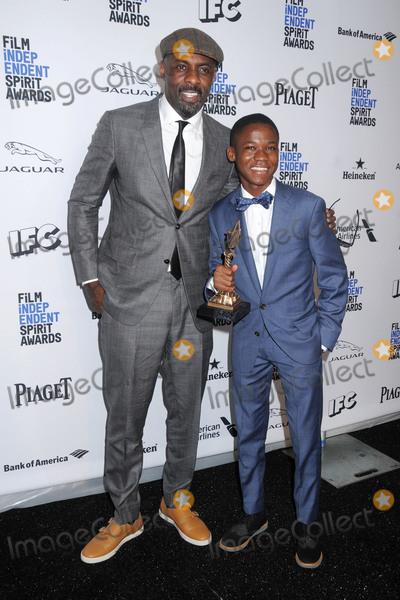 Idris Elba, Abraham Attah Photo - 27 February 2016 - Santa Monica, California - Idris Elba, Abraham Attah. 31st Annual Film Independent Spirit Awards - Press Room held at the Santa Monica Pier. Photo Credit: Byron Purvis/AdMedia