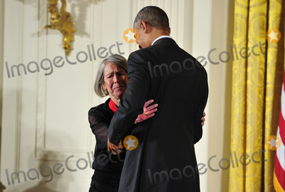 Barack Obama, President Barack Obama, White House, The White Photo - In this file photo from September 22, 2016, United States President Barack Obama presents the 2015 National Humanities Medal to Louise Glck, Poet of Cambridge, Massachusetts during a ceremony in the East Room of the White House in Washington, DC.  On October 8, 2020, the Nobel Prize announced Louise Glck was being awarded the 2020 Nobel Prize in Literature.