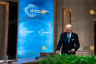Joe Biden, White House, The White Photo - United States President Joe Biden arrives to deliver remarks during Session 5: The Economic Opportunities of Climate Action of the virtual Leaders Summit on Climate, in the East Room of the White House in Washington DC on April 23rd, 2021. Credit: Anna Moneymaker / Pool via CNP/AdMedia