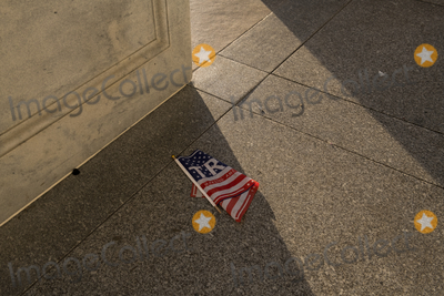The Unit, Vandals Photo - Items left on the floor at the entrance of the U.S. Capitol in the aftermath the morning after a riot by pro-Trump supporters who stormed and vandalized the U.S. Capitol as Electoral votes were being counted during a joint session of the United States Congress to certify the results of the 2020 presidential election. Washington, DC, Thursday, January 7, 2021. Credit: Rod Lamkey / CNP/AdMedia