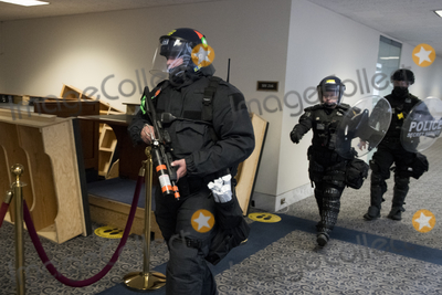 The Unit, The Used Photo - Members of a Secret Service tactical team arrive as Senators evacuate to a safe place in the Dirksen Senate Office Building after Electoral votes being counted during a joint session of the United States Congress to certify the results of the 2020 presidential election in the US House of Representatives Chamber in the US Capitol in Washington, DC on Wednesday, January 6, 2021, as interrupted as thousands of pr-Trump protestors stormed the U.S. Capitol and the House chambers.  .