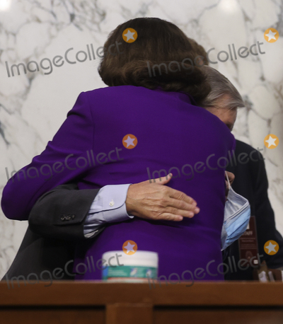 Dianne Feinstein, Donald Trump, Lindsey Graham, Senator Dianne Feinstein, Senator Lindsey Graham, Supremes, Supreme Court Photo - United States Senator Lindsey Graham (Republican of South  Carolina), Chairman, US Senate Judiciary Committee and United States Senator Dianne Feinstein (Democrat of California), Ranking Member, US Senate Judiciary Committee, hug at the conclusion of the fourth day of the confirmation hearing for Judge Amy Coney Barrett, President Donald Trump's Nominee for Supreme Court, in Hart Senate Office Building in Washington DC, on October 15th, 2020.Credit: Jonathan Ernst / Pool via CNP