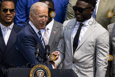 Photo - United States President Joe Biden shakes hands with Tampa Bay Buccaneers wide receiver Chris Godwin (14) prior to making remarks welcoming the 2021 the Super Bowl LV (Super Bowl 55) Champion Tampa Bay Buccaneers to the White House in Washington, D.C. on July 20, 2021.  The event marked the first visit to the White House by the reigning Super Bowl champions in four years.Credit: Samuel Corum / CNP/AdMedia