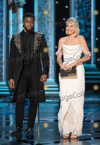 Margot Robbie, Chadwick Boseman Photo - 04 March 2018 - Hollywood, California - Chadwick Boseman and Margot Robbie. 90th Annual Academy Awards presented by the Academy of Motion Picture Arts and Sciences held at the Dolby Theatre. Photo Credit: A.M.P.A.S./AdMedia