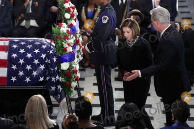 "Elijah Cummings, Nancy Pelosi, Representative Nancy Pelosi, The Unit, Alex Wong Photo - Speaker of the United States House of Representatives Nancy Pelosi (Democrat of California) and US House Minority Leader Kevin McCarthy (Republican of California) lay a wreath during a memorial service for the late US Representative Elijah Cummings (Democrat of Maryland) at the Statuary Hall of the U.S. Capitol October 24, 2019 in Washington, DC. Rep. Cummings passed away on October 17, 2019 at the age of 68 from ""complications concerning longstanding health challenges."" 