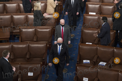 The Unit, The Used Photo - Electoral votes are counted during a joint session of the United States Congress to certify the results of the 2020 presidential election in the US House of Representatives Chamber in the US Capitol in Washington, DC on Wednesday, January 6, 2021.  Congressional Republicans have announced they are going to challenge the Electoral votes from up to six swing states.Credit: Rod Lamkey / CNP/AdMedia