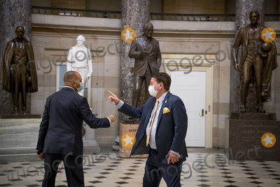 The Used, Hakeem Jeffries Photo - United States Representative Hakeem Jeffries (Democrat of New York), left, greets a man in Statuary Hall as members of Congress vote on two House resolutions at the US Capitol in Washington, DC., Friday, October 2, 2020. The Resolutions are: House Resolution 1153: Condemning unwanted, unnecessary medical procedures on individuals without their full, informed consent and House Resolution 1154: Condemning QAnon and rejecting the conspiracy theories it promotes. 