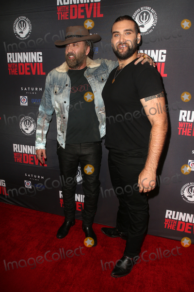 """Nicolas Cage, Weston Coppola Cage, Nicolas Cazalé Photo - 16 September 2019 - Beverly Hills, California - Nicolas Cage, Weston Coppola Cage. Premiere Of Quiver Distribution's """"Running With The Devil held at Writers Guild Theater. Photo Credit: FSadou/AdMedia"""