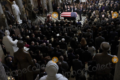 """Elijah Cummings, Alex Wong Photo - The flag-draped casket of United States Representative Elijah Cummings (Democrat of Maryland) is seen during a memorial service for the late congressman at the Statuary Hall of the U.S. Capitol October 24, 2019 in Washington, DC. Rep. Cummings passed away on October 17, 2019 at the age of 68 from """"complications concerning longstanding health challenges."""" Credit: Alex Wong / Pool via CNP/AdMedia"""