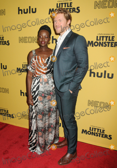 "Lupita Nyong'o, Lupita  Nyong'o, Alexander England Photo - 08 October 2019 - New York, New York - Lupita Nyong'o, Alexander England. ""Little Monsters"" New York Premiere held at AMC Lincoln Square Theater. Photo Credit: AdMedia"