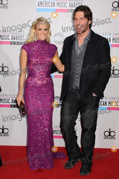 Carrie Underwood, Mike Fisher Photo - 18 November 2012 - Los Angeles, California - Carrie Underwood, Mike Fisher. 40th Anniversary American Music Awards - Arrivals held at Nokia Theatre L.A. Live. Photo Credit: Byron Purvis/AdMedia