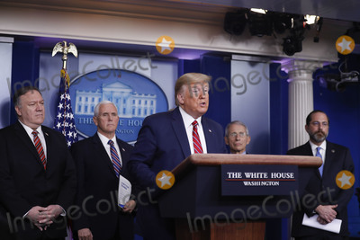 Donald Trump, Mike Pence, White House, The White, The National, Alex Azar, Mike Pompeo, Anthony Fauci Photo - United States President Donald J. Trump speaks during a Coronavirus Task Force news conference in the briefing room of the White House in Washington, D.C., U.S., on Friday, March 20, 2020. Americans will have to practice social distancing for at least several more weeks to mitigate U.S. cases of Covid-19, Director of the National Institute of Allergy and Infectious Diseases at the National Institutes of Health Dr. Anthony Fauci said today. From left to right behind the President: US Secretary of State Mike Pompeo; US Vice President Mike Pence; Director of the National Institute of Allergy and Infectious Diseases at the National Institutes of Health Dr. Anthony Fauci; and US Secretary of Health and Human Services (HHS) Alex Azar.Credit: Al Drago / Pool via CNP/AdMedia