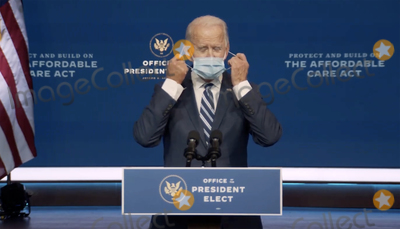 Joe Biden, Queen Photo - In this image from the Biden Presidential Transition video feed, United States President-elect Joe Biden removes his mask as he prepares to make a statement on the Affordable Care Act at the Queen Theatre in Wilmington, Delaware on Tuesday, November 10, 2020.Credit: Biden Presidential Transition via CNP/AdMedia