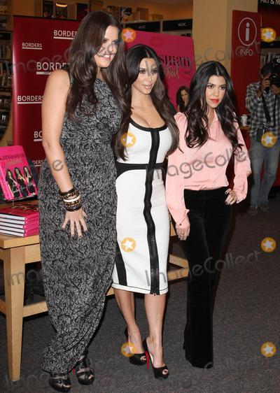 Khloe Kardashian, Kim Kardashian, Kourtney Kardashian, Khloe' Kardashian, Khloe  Kardashian Photo - 2 December 2010 - Century City, CA - Khloe Kardashian, Kim Kardashian, Kourtney Kardashian. Kardashian sisters sign copies of their new book 'Kardashian Konfidential' held At Borders Book Store. Photo: Kevan Brooks/AdMedia