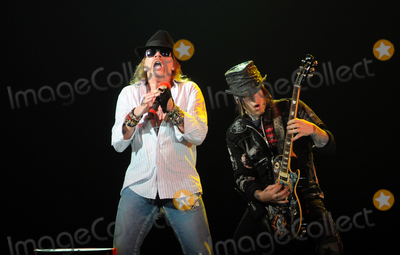 "Axl Rose, DJ Ashba, Guns N' Roses Photo - 24 January 2010 - Hamilton, Ontario, Canada.  Axl Rose and DJ Ashba of Guns N' Roses perform on stage at Copps Coliseum in support of ""Chinese Democracy"".  Photo Credit: Brent Perniac/AdMedia"