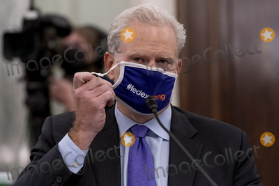 Richard Smith Photo - FedEx Express Regional President of the Americas and Executive Vice President Richard Smith removes his face mask to speak at a Senate Transportation subcommittee hybrid hearing on transporting a coronavirus vaccine on Capitol Hill, Thursday, Dec. 10, 2020, in Washington.Credit: Andrew Harnik / Pool via CNP/AdMedia