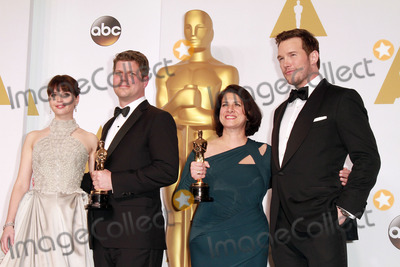Chris Pratt, Felicity Jones, Adam Stockhausen, Anna Pinnock Photo - 22 February 2015 - Hollywood, California -L-R) Actress Felicity Jones, Adam Stockhausen, Anna Pinnock, winners of the Best Production Design Award for 'The Grand Budapest Hotel', and presenter Chris Pratt pose in the press room during the 87th Annual Academy Awards presented by the Academy of Motion Picture Arts and Sciences held at the Dolby Theatre. Photo Credit: Theresa Bouche/AdMedia