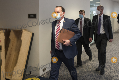 The Unit, The Used, Mike Lee Photo - United States Senator Mike Lee (Republican of Utah) and other Senators evacuate to a safe place in the Dirksen Senate Office Building after Electoral votes being counted during a joint session of the United States Congress to certify the results of the 2020 presidential election in the US House of Representatives Chamber in the US Capitol in Washington, DC on Wednesday, January 6, 2021, as interrupted as thousands of pr-Trump protestors stormed the U.S. Capitol and the House chambers.  .Credit: Rod Lamkey / CNP/AdMedia