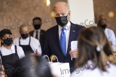 Joe Biden Photo - United States President Joe Biden speaks to workers as he picks up tacos during a visit to Las Gemelas Restaurant  in Washington, DC, USA, 05 May 2021.United States President Joe Biden picks up tacos during a visit to Las Gemelas Restaurant  in Union Market to highlight the successes of the American Rescue Plan (ARP) in Washington, DC, USA, 05 May 2021.  Las Gemelas is a beneficiary of relief funding from the pilot program Restaurant Revitalization Fund.  The ARPs Restaurant Revitalization Fund provides $28.6 billion in direct relief to restaurants and food and beverage establishments, and prioritizes restaurants that are women-owned, veteran-owned, and owned by other socially and economically disadvantaged individuals.Credit: Jim LoScalzo / Pool via CNP/AdMedia