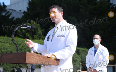 Photo - Commander Sean P. Conley, Physician to the President, gives an update on the condition of US President Donald J. Trump at the Walter Reed National Military Medical Center in Bethesda, Maryland, 04 October 2020. The President is at Walter Reed for treatment following a positive test for COVID-19 on 02 October.