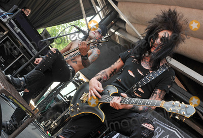Jake Pitts, Ashley Purdy Photo - 20 July 2011 - Cleveland, OH - Bassist ASHLEY PURDY and guitarist JAKE PITTS of the band BLACK VEIL BRIDES performs on a stop of the Vans Warped Tour 2011 held at the Blossom Music Center.  Photo Credit: Jason L Nelson/AdMedia
