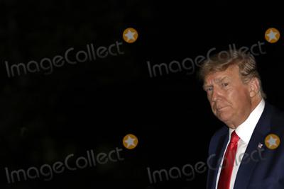 White House, The White Photo - United States President Donald J. Trump walks on the South Lawn of the White House upon his return to Washington, DC from Georgia on October 16, 2020. Credit: Yuri Gripas / Pool via CNP