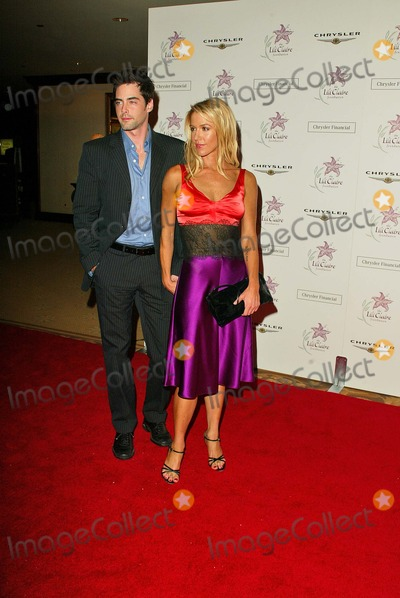 Poppy Montgomery, Adam Kaufman, Matthew Perry Photo - Poppy Montgomery and Adam Kaufman at the The Lili Claire Foundations 7th Annual Benefit Gala Hosted by Matthew Perry, Century Plaza Hotel, Los Angeles, CA 11-16-04