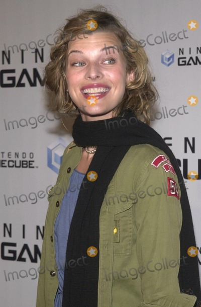 Milla Jovovich Photo -  MILLA JOVOVICH at the launch party for the new Nintendo Game Cube system, sponsored by MTV, in Hollywood, 10-03-01